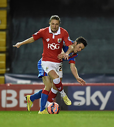 Bristol City's Luke Ayling controls the ball under pressure from Doncaster Rovers Harry Middleton during the FA Cup third round replay between Bristol City and Doncaster Rovers at Ashton Gate on January 13, 2015 in Bristol, England - Photo mandatory by-line: Paul Knight/JMP - Mobile: 07966 386802 - 13/01/2015 - SPORT - Football - Bristol - Ashton Gate Stadium - Bristol City v Doncaster Rovers - FA Cup third round replay