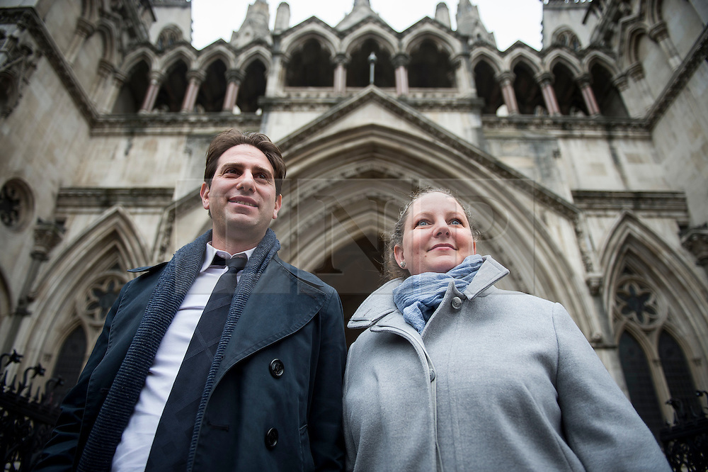 """© Licensed to London News Pictures. 29/01/2016. London, UK. Heterosexual couple CHARLES KEIDAN and REBECCA STEINFELD leave the Royal Courts of Justice in London, where they have lost their High Court battle to have a civil partnership.. The couple, who are both academics and live in London, argued that the Government's position on civil partnerships is """"incompatible with equality law"""".  Photo credit: Ben Cawthra/LNP"""