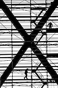 Workers on scaffolding in Lions Gate Bridge tower, Vancouver, BC, Canada