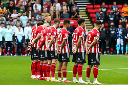 Sheffield United players during the minutes applause during the Sky Bet Championship match at Bramall Lane, Sheffield. Picture date: Saturday September 25, 2021.