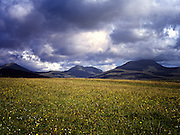 View across a field and of Mountains on South Uist, Hebrides, Scotland.