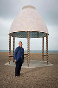 Turner Prize nominated Lubaina Himid MBE with her Jelly Mould Pavilion on Folkestone's sea front as part of the 2017 Folkestone Triennial. Folkestone, Kent. Lubaina Himid created a Jelly Mould Pavilion on Folkestone's sea front, on the former 'Rotunda' site of the town's fun fair, Lido and amusement park where the sugar of candy floss and toffee apples fuelled summer visitors. The pavilion's colourful decoration in the artist's signature patterning will serve as a reminder of the lost amusement park, as well as providing a beautiful shelter at the edge of the town to rest, look out to sea, and think about the role of sugar in Britain's history. Folkestone, Kent.