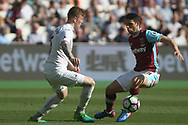 Jonathan Calleri of West Ham United (R) is tackled by Alfie Mawson of Swansea City (L). Premier league match, West Ham Utd v Swansea city at the London Stadium, Queen Elizabeth Olympic Park in London on Saturday 8th April 2017.<br /> pic by Steffan Bowen, Andrew Orchard sports photography.