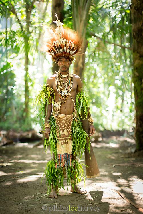 Man wearing traditional dress and headdress, Mclaren Harbour, Tufi, Cape Nelson, Oro Province, Papua New Guinea