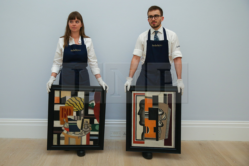 © Licensed to London News Pictures. 29/01/2020. London, UK. Technicians rest by holding Fernand Leger's painting titled Nature Morte (L) (est £2.2m to £2.8m) and Fernand Léger's painting tilted Le Buste (R) (est £1.3m to £1.6m) at the preview of Sotheby's Impressionist, Modern and Surrealist art sales. The auction will take place at Sotheby's in central London on 4 and 5 February 2020. Photo credit: Dinendra Haria/LNP