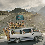 Ismaili Scouts return home after a day's excursion to a nearby village.