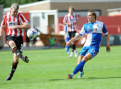 Arron Downes of Cheltenham Town clears from Billy Bodin of Bristol Rovers - Mandatory by-line: Neil Brookman/JMP - 25/07/2015 - SPORT - FOOTBALL - Cheltenham Town,England - Whaddon Road - Cheltenham Town v Bristol Rovers - Pre-Season Friendly