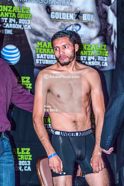 LOS ANGELES, California/USA (Friday, Aug 23 2013) -  Jhonny Gonzalez (54-8, 46 KOs) weighed 125 pounds during the weigh in at the Millennium Biltmore Hotel on August 23, 2013 in Los Angeles, California. Gonzalez, a tall and rangy veteran who used to struggled to make 118 pounds, said making weight was the least of his problems. PHOTO © Eduardo E. Silva/SILVEXPHOTO.COM.
