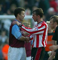 Southampton's Claus Lundekvam shakes hands with Aston Villa's Ronny Johnson at the end of the game