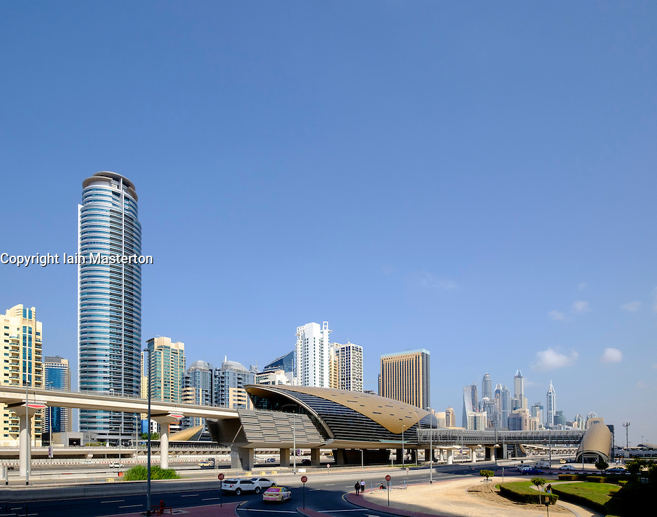 Skyline view of Dubai and modern elevated railway station for Dubai Metro system in United Arab Emirates