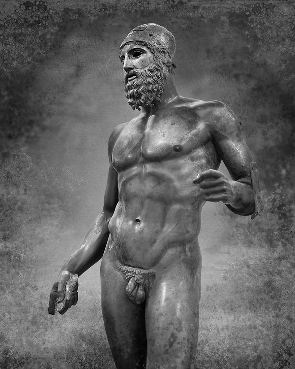 Torso of the Riace bronze Greek statue B cast about 460 - 450 BC. statue B was probably sculpted by Phidias. There is a sense of movement in the statues their legs being bent as if they are about to take a step. Their heads are turned which accentuates a sense of anticipation as if they are looking for something. The anatomical detail is extraordinary which gives a startling realism to the statue and demonstarte the high level of skill of the Greek sculptors of this peiod. Museo Nazionale della Magna Grecia,  Reggio Calabria, Italy. Black and White Wall art print by Photographer Paul E Williams