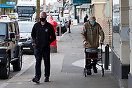Locals wearing masks are seen walking on the main street amid fears of an outbreak spreading during COVID-19 in Kilmore, Australia. An outbreak which started in Chadstone in Melbourne, has spread as far as Benalla. Twenty-eight people linked to the outbreak have now tested positive for COVID-19. There are now two confirmed cases in Kilmore linked with a Melbourne Resident who carried the virus into the town. The person visited the Odd Fellows Cafe in Kilmore which lead to him spreading the virus to a staff member, and a customer. The cafe has been closed for deep cleaning and will remain closed until the 19th October. (Photo by Dave Hewison/Speed Media)