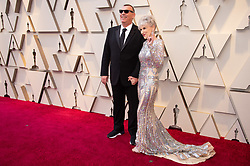 February 24, 2019 - Hollywood, California, U.S. - Oscar nominee, Graham King and guest arrives on the red carpet of The 91st Oscars at the Dolby Theatre in Hollywood. (Credit Image: ? AMPAS/ZUMA Wire/ZUMAPRESS.com)