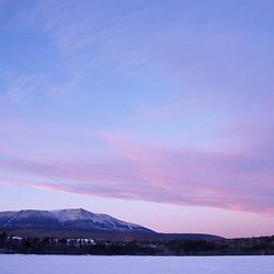Golden Road near Abol Bridge, ME. Sunset clouds above Maine's Mt. Katahdin in winter.