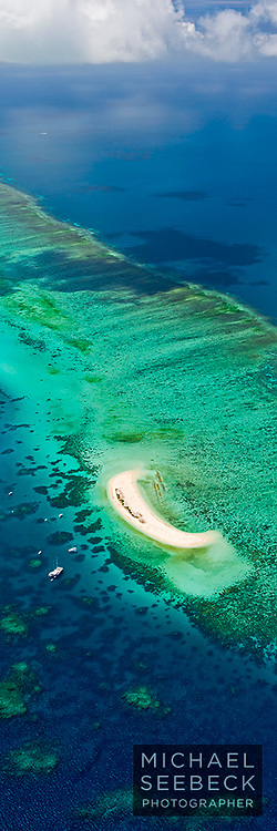 A vertical panoramic photograph of Michaelmas Cay, as captured from a helicopter.