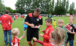 Bristol City manager, Steve Cotterill signs autographs for young fans - Photo mandatory by-line: Dougie Allward/JMP - Mobile: 07966 386802 - 05/07/2015 - SPORT - Football - Bristol - Brislington Stadium - Pre-Season Friendly