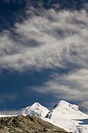 Castor and Pollox under streaky clouds, from Rifflesee, nr Zermatt, Switzerland