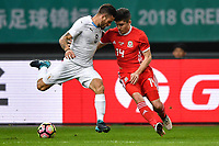 """Declan John, right, of Wales national football team challenges Nahitan Nandez of Uruguay national football team in their final match during the 2018 Gree China Cup International Football Championship in Nanning city, south China's Guangxi Zhuang Autonomous Region, 26 March 2018.<br /> <br /> Edinson Cavani's goal in the second half helped Uruguay beat Wales to claim the title of the second edition of China Cup International Football Championship here on Monday (26 March 2018). """"It was a tough match. I'm very satisfied with the result and I think that we can even get better if we didn't suffer from jet lag or injuries. I think the result was very satisfactory,"""" said Uruguay coach Oscar Tabarez. Wales were buoyed by a 6-0 victory over China while Uruguay were fresh from a 2-0 win over the Czech Republic. Uruguay almost took a dream start just 3 minutes into the game as Luis Suarez's shot on Nahitan Nandez cross smacked the upright. Uruguay were dealt a blow on 8 minutes when Jose Gimenez was injured in a challenge and was replaced by Sebastian Coates. Inter Milan's midfielder Matias Vecino of Uruguay also fired at the edge of box from a looped pass but only saw his attempt whistle past the post. Suarez squandered a golden opportunity on 32 minutes when Ashley Williams's wayward backpass sent him clear, but the Barca hitman rattled the woodwork again with goalkeeper Wayne Hennessey well beaten."""