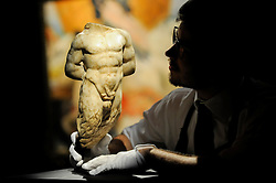 "© Licensed to London News Pictures. 10/02/2017. London, UK.  A technician inspects a 2nd century Roman Marble Torso of Pan (est. GBP40-60k), at the preview of the ""Erotic: Passion & Desire"" sale at Sotheby's in New Bond Street.  The sale, which will take place on 16 February, encompasses representations of love and sex from antiquity to the present day.  Photo credit : Stephen Chung/LNP"