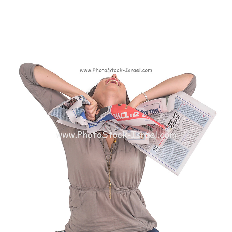 excited and emotional young woman ripping up a printed newspaper studio shot on white background