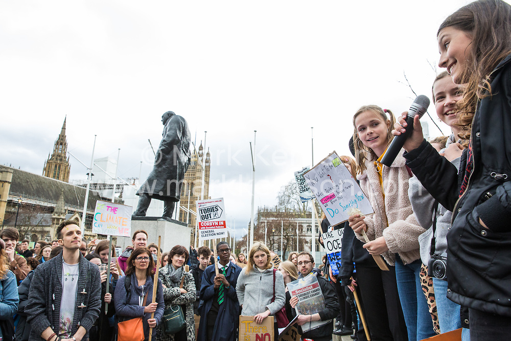 London, UK. 15th March, 2019. Thousands of students take part in the second Youth Strike 4 Climate. After gathering in Parliament Square, students marched to Buckingham Palace and then joined a protest by Extinction Rebellion which blocked Westminster Bridge. The strike was organised by UK Student Climate Network and the UK Youth Climate Coalition to demand that the Government declare a climate emergency and take positive steps to address the climate crisis, including highlighting the issue as part of the school curriculum, as well as lowering the voting age to 16, and similar events were held around the world.