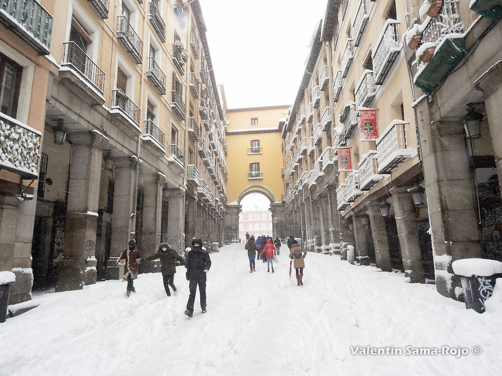 Madrid, Spain. 9 th January, 2021. People walking at the Toledo street near Plaza Mayor square. Storm Filomena hits Madrid (Spain), a weather alert was issued for cold temperatures and heavy snow storms across Spain; according to the weather agency Aemet is expected to be one of the snowiest days in recent years. © Valentin Sama-Rojo.