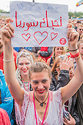 I love Syria placard - Damon Albarn introduces and plays with the Orchestra of Syrian Musicians on the Pyramid Stage - The 2016 Glastonbury Festival, Worthy Farm, Glastonbury.