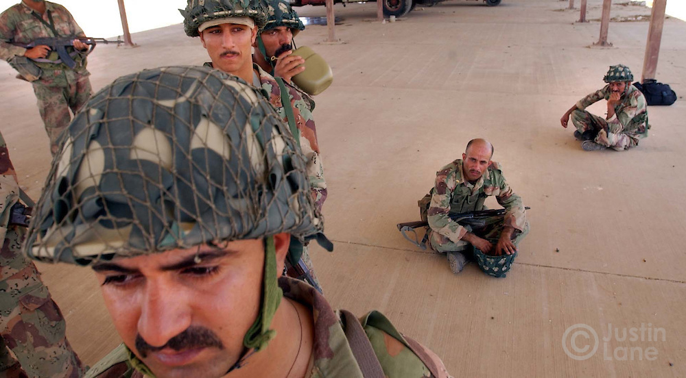 09/20/03--Kir Kush Military Base, Iraq--Attn: Foriegn--Members of the New Iraqi Army are seen during training this afternoon at Kir Kush Military Base, located east of Baghdad. The first Battalion of new troops, who are being trained by the Vinnell Corp., will graduate the course on Oct 4, 2003.