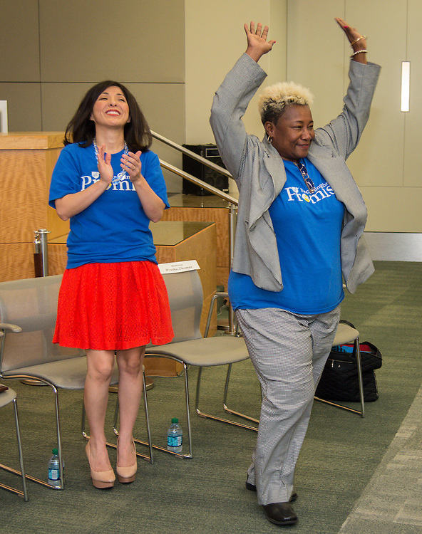 Houston ISD board of trustees president Juliet Stipeche, left, and Houston Educational Support Personnel president Wretha Thomas, right, react during ceremony recognizing the District's employee anti-bullying policy, September 12, 2014.