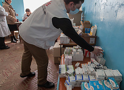 Ihor Roznatovskyi fullfils medical prescriptions for patients at an MSF mobile clinic in the town of Sukodolsk near to Lugansk.