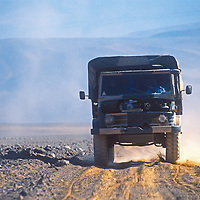 An Argeninte made Unimog transport drives on a bumpy dirt road across the vast Altiplano of northern Argentina.