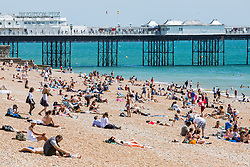 © Licensed to London News Pictures. 18/07/2017. Brighton, UK. Members of the public enjoy the sunny and hot weather by spending lunchtime on the beach in Brighton and Hove. Photo credit: Hugo Michiels/LNP