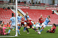 Manchester City midfielder Keira Walsh (24) clears the danger from Manchester United midfielder Kirsty Hanson (18) in the final minutes during the FA Women's Super League match between Manchester United Women and Manchester City Women at Leigh Sports Village, Leigh, United Kingdom on 14 November 2020.