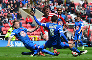 John Swift is tackled by Mathieu Baudry during the Sky Bet League 1 match between Swindon Town and Leyton Orient at the County Ground, Swindon, England on 3 May 2015. Photo by Alan Franklin.