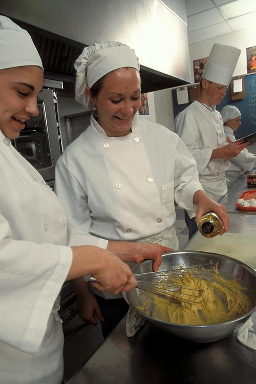 Female and male High School students participate in culinary arts program in Austin, Texas.   Model Release.<br /> ©Bob Daemmrich