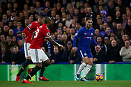 Eden Hazard of Chelsea is tracked by Chris Ssmalling and Ashley Young of Manchester United. Premier league match, Chelsea v Manchester United at Stamford Bridge in London on Sunday 5th November 2017.<br /> pic by Kieran Clarke, Andrew Orchard sports photography.