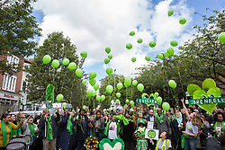 London, UK. 14 June, 2019. Family members release green balloons following a memorial service at St Helen's Church to mark the second anniversary of the Grenfell Tower fire on 14th June 2017 in which 72 people died and over 70 were injured.