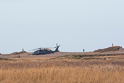 © Licensed to London News Pictures. 08/01/2013. Cley Next to Sea, UK. The scene where a US Air Force (USAF) helicopter crashed on marshland on Cley Next to Sea, Norfolk. Four people are believed to have died when the  HH-60G Pave Hawk helicopter came down over a nature reserve while on a training exercise. Photo credit : Terry Harris/LNP