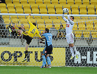 Sydney FC keeper Ivan Necevski makes a save from  Wellington Phoenix's Alex Smith in the A-League foootball match at Westpac Stadium, Wellington, New Zealand, Saturday, October 06, 2012. Credit:SNPA / Ross Setford