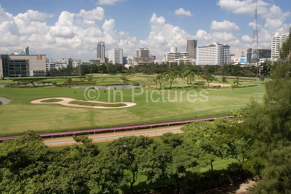 Beside Ratchadamri BTS skytrain station is the Royal Bangkok Sports Club. Here a scaled down golf course sits amid this vast city.