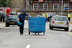 © Licensed to London News Pictures. 15/08/2013. Lewisham, London. Police search Eastdown Park Road in Lewisham after a woman was found murdered at a property here yesterday. Photo credit: David Mirzoeff/LNP