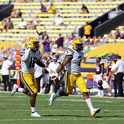 Sep 26, 2020; Baton Rouge, Louisiana, USA; LSU Tigers safety JaCoby Stevens (7) celebrates with teammate linebacker Damone Clark (18) after recovering a fumbled snap against the Mississippi State Bulldogs during the first half at Tiger Stadium. Mandatory Credit: Derick E. Hingle-USA TODAY Sports