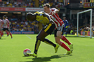 Allan-Romeo Nyom of Watford holds the ball from Matt Targett of Southampton. Barclays Premier League, Watford v Southampton at Vicarage Road in London on Sunday 23rd August 2015.<br /> pic by John Patrick Fletcher, Andrew Orchard sports photography.