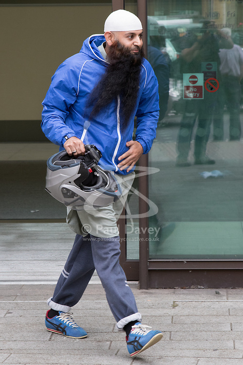 """Westminster Magistrates Court, London, August 5th 2015. Islamist Anjem Choudary is denied bail on terror charges at Westminster Magistrates Court. A colleague Mohammad Shamsuddin, also known as Abu Saalihah issued a press statement saying Choudary and his co-accused Mohammed Rahman will be remanded in custody until August 28th and declared the charges as part of an ongoing persecution of Muslims, declaring that """"one day the black flag of Islam WILL be flying over Westminster"""". PICTURED: A supporter of Choudary arrives at Westminster Magistrates Court"""