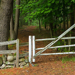 A wooden gate at the entrance to a trail in Medfield, Massachusetts.