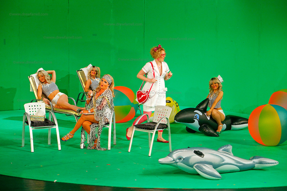 Picture shows : Mary O'Sullivan as Elvira (seated front) and Julia Riley as Zulma (standing) with bunny girls..Picture  ©  Drew Farrell Tel : 07721 -735041..A new Scottish Opera production of  Rossini's 'The Italian Girl in Algiers' opens at The Theatre Royal Glasgow on Wednesday 21st October 2009..(Soap) opera as you've never seen it before..Tonight on Algiers.....Colin McColl's cheeky take on Rossini's comic opera is a riot of bunny girls, beach balls, and small screen heroes with big screen egos. Set in a TV studio during the filming of popular Latino soap, Algiers, the show pits Rossini's typically playful and lyrical music against the shoreline shenanigans of cast and crew. You'd think the scandal would be confined to the outrageous storylines, but there's as much action off set as there is on.....Italian bass Tiziano Bracci makes his UK debut in the role of Mustafa. Scottish mezzo-soprano Karen Cargill, who the Guardian called a 'bright star' for her performance as Rosina in Scottish Opera's 2007 production of The Barber of Seville, sings Isabella..Cast .Mustafa...Tiziano Bracci.Isabella..Karen Cargill.Lindoro...Thomas Walker.Elvira...Mary O'Sullivan.Zulma...Julia Riley.Haly...Paul Carey Jones.Taddeo...Adrian Powter..Conductors.Wyn Davies.Derek Clarke (Nov 14)..Director by Colin McColl.Set and Lighting Designer by Tony Rabbit.Costume Designer by Nic Smillie..New co-production with New Zealand Opera.Production supported by.The Scottish Opera Syndicate.Sung in Italian with English supertitles..Performances.Theatre Royal, Glasgow - October 21, 25,29,31..Eden Court, Inverness - November 7. .His Majesty's Theatre, Aberdeen  - November 14..Festival Theatre,Edinburgh - November 21, 25, 27 ...Note to Editors:  This image is free to be used editorially in the promotion of Scottish Opera. Without prejudice ALL other licences without prior consent will be deemed a breach of copyright under the 1988. Copyright Design and Patents Act  and will be subject to payment or