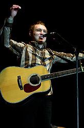 David Grey plays a Concert to a sellout Sheffield Hallam FM Arena  November 29 2002 Friday<br /><br />Copyright Paul David Drabble<br />Freelance Photographer<br />07831 853913<br />0114 2468406<br />www.pauldaviddrabble.co.uk<br /> [#Beginning of Shooting Data Section]<br />Nikon D1 <br /> 2002/11/29 21:51:55.4<br /> JPEG (8-bit) Fine<br /> Image Size:  2000 x 1312<br /> Color<br /> Lens: 80-200mm f/2.8-2.8<br /> Focal Length: 80mm<br /> Exposure Mode: Manual<br /> Metering Mode: Spot<br /> 1/200 sec - f/2.8<br /> Exposure Comp.: 0 EV<br /> Sensitivity: ISO 400<br /> White Balance: Auto<br /> AF Mode: AF-S<br /> Tone Comp: Normal<br /> Flash Sync Mode: Not Attached<br /> Color Mode: <br /> Hue Adjustment: <br /> Sharpening: Normal<br /> Noise Reduction: <br /> Image Comment: <br /> [#End of Shooting Data Section] David Grey plays a Concert to a sell out Sheffield Hallam FM Arena November 29 2002 Friday<br /> <br /> Copyright Paul David Drabble<br /> Freelance Photographer<br /> 07831 853913<br /> 0114 2468406