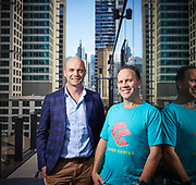 Angus McDonald (shaved head) and Christopher Bayley (tee shirt), founders of fintech company, Cover Genius pictured in Sydney, Australia