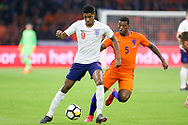 England forward Marcus Rashford battles with Netherlands Midfielder Georginio Wijnaldum (Liverpool) during the Friendly match between Netherlands and England at the Amsterdam Arena, Amsterdam, Netherlands on 23 March 2018. Picture by Phil Duncan.