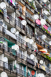 Many satellite dishes on balconies on social housing apartment blocks at Pallasseum on Pallastrasse in Schoeneberg district of Berlin, Germany.